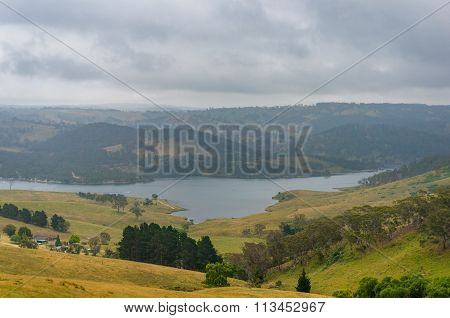 Beautiful countryside farms and paddocks with Lake Lyell on the background. New South Wales Australia