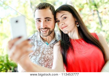 Dating young couple happy in love taking selfie self-portrait ph