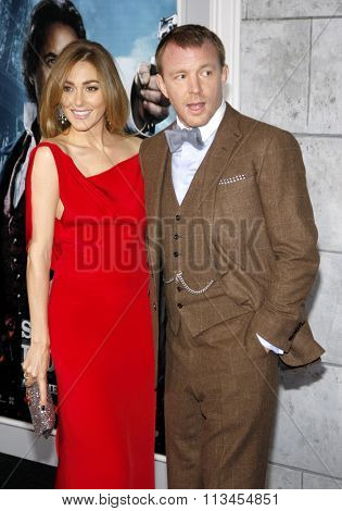 WESTWOOD, CALIFORNIA - December 6, 2011. Guy Ritchie and Jacqui Ainsley at the Los Angeles premiere of
