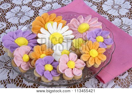 Flower Sugar Cookies in glass plate white lace table cloth