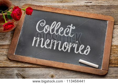 Collect memories  - white chalk text on a vintage slate blackboard with red roses against rustic wood