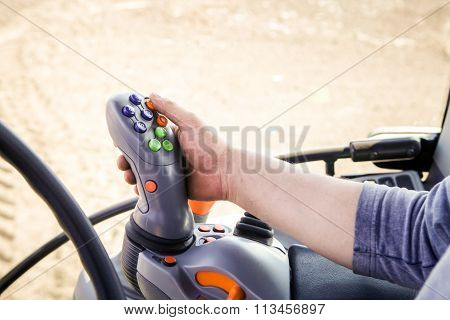 Closeup Man Touches Handle With Buttons On Instrument Panel