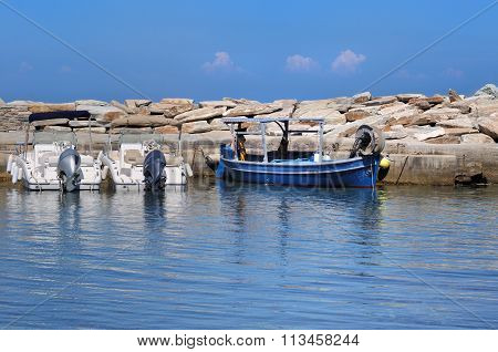 Blue Boat On Blue Sea