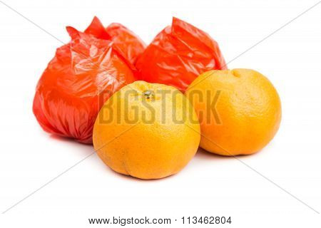 Mandarin Oranges With Plastic Protective Wrapper Isolated In White