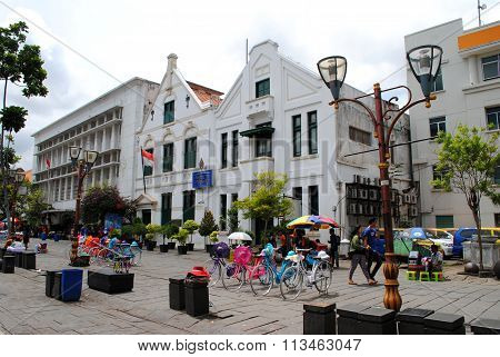 Colonial buildings and bicycles for hire in the old town of Jakarta, Indonesia
