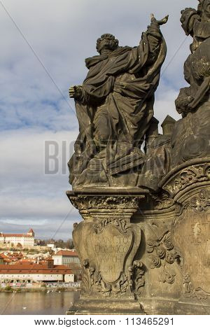 Statue Of The Madonna, St. Dominic And Thomas Aquinas On Charles Bridge In Prague