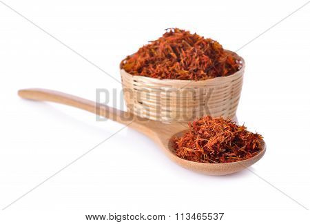 Dried Safflower In Basket And Spoon On White Background