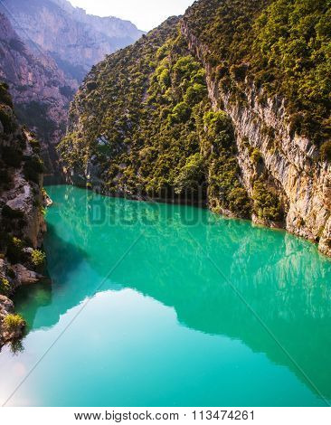 Spring Provence.  Smooth-blue water reflecting the clouds. The biggest mountain canyon in Europe - Verdon