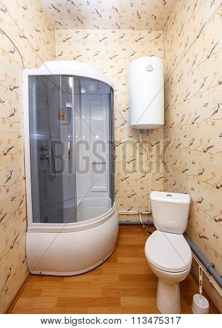 Interior Of Hotel Bathroom With Shower And Pan