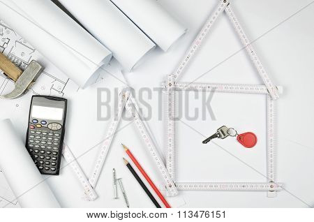 White Meter Tool Forming A House And Engineering Tools On White Paper Background