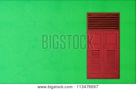 Christmas Theme For Copy Space , Classic Red Wooden Windows On Green Rough Cement Background