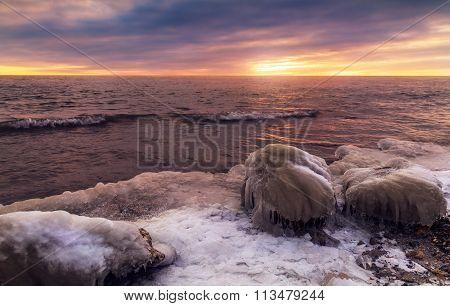 Sunrise With Stone On Ice. Winter Landscape