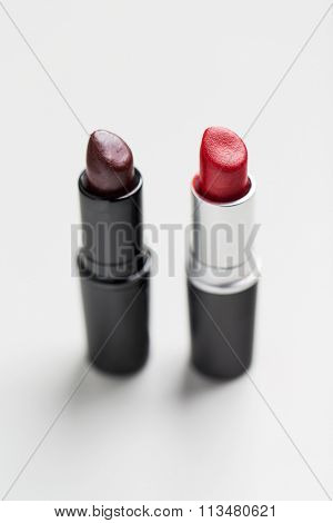 close up of two open lipsticks
