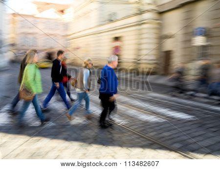 Ople Crossing The Street On The Zebra Crossing