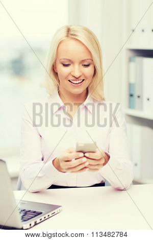 smiling businesswoman or student with smartphone