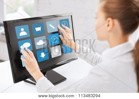 businesswoman with computer touchscreen in office