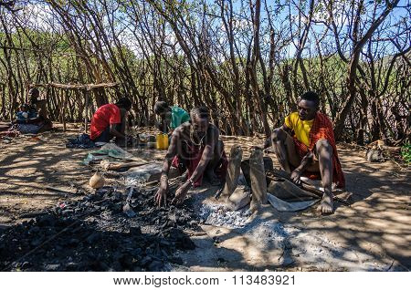 Datoga Man Working, Lake Eyasi, Tanzania