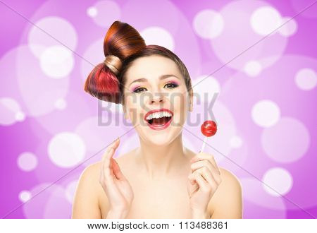 Beautiful smiling woman with a lollipop on bubbly background.