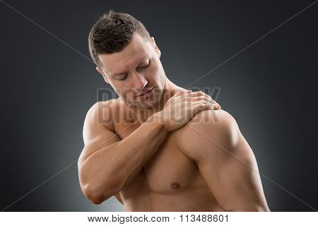 Muscular Man Suffering From Shoulder Pain