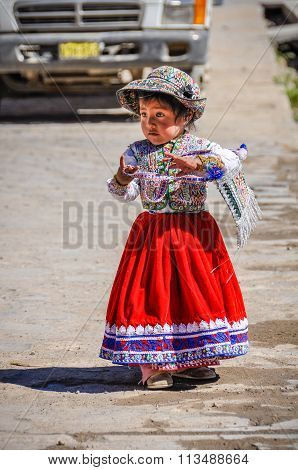 Quechua Girl In Cabanaconde In The Colca Canyon, Peru