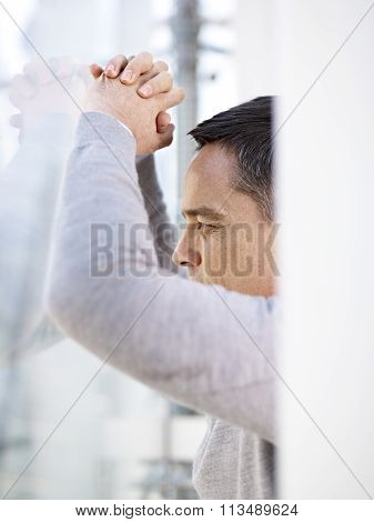Businessman Looking Out Window Thinking