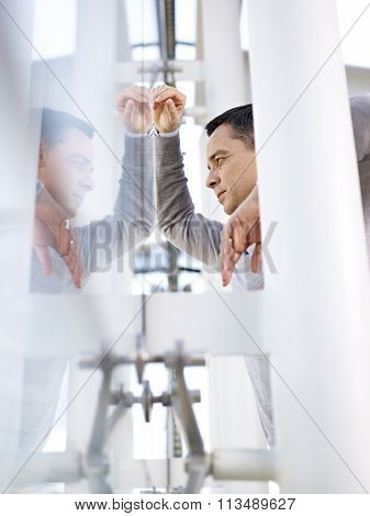 Businessman Looking Out Of Window Thinking