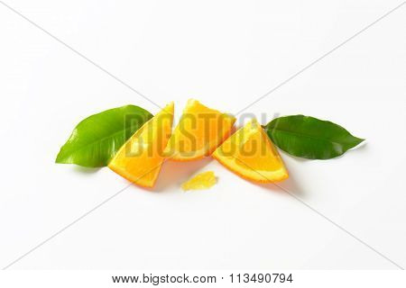 Pieces of fresh orange with leaves