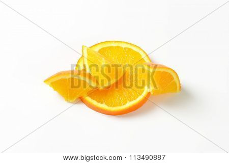 Pieces of fresh orange on white background