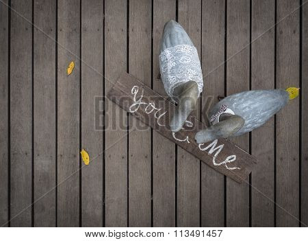 Mr And Mrs Duck On Wooden Floor