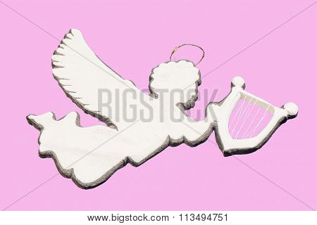 Silver Flying Angel Gigurine Ornament Holding Harp Isolated On Pink Background