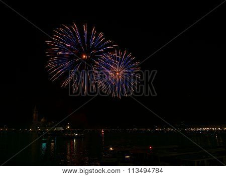 Blue fireworks explode in Venice in dark sky,New Year firew