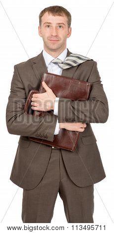 Businessman hugging suitcase