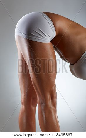 Sexy muscular body parts of a woman