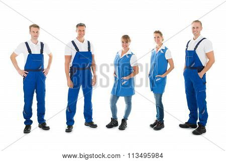 Portrait Of Confident Janitors Standing In Row