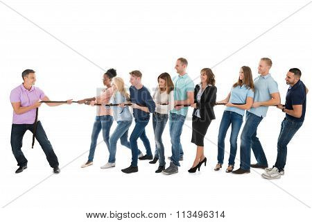 Leader Pulling Creative Business Team While Playing Tug Of War