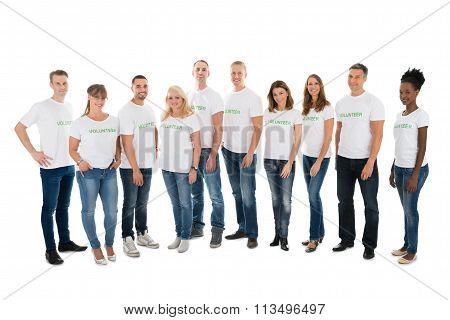 Portrait Of Confident Volunteers Standing In Row