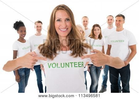 Happy Woman Showing Volunteer Text On Tshirt