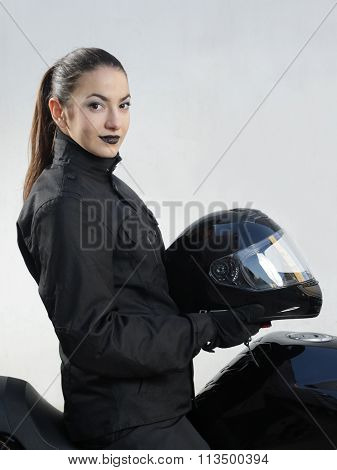 The Motorcyclist Girl  In Black Hold A Helmet
