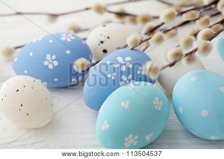 colorful easter eggs and pussy willow branches