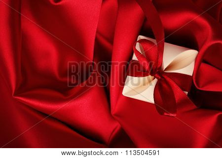 gift box on red silk background. valentines day
