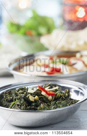 Indian Spinach Curry In Metal Bowls