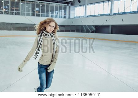 Young Brunette Woman Ice Skating