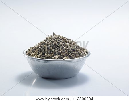 bowl of  cumin on the white background