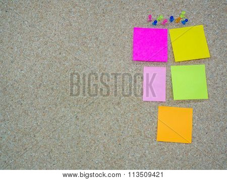 Group Of Thumbtacks Pinned And Paper Note On Cork Board