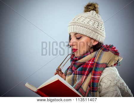 Thoughtful Woman Reading A Book
