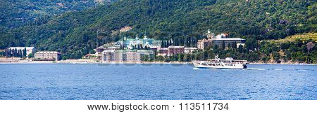 Panorama of Russian St. Panteleimon Orthodox monastery at Mount Athos,  Halkidiki , Greece and ship