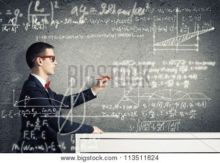 Student drawing science formulas