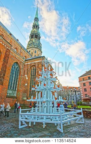RIGA LATVIA - DECEMBER 25 2011: Christmas tree with birds at St Peter church in the Old city of Riga in Latvia