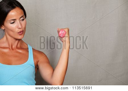 Healthy Lady Taking Weights And Holding The Breath