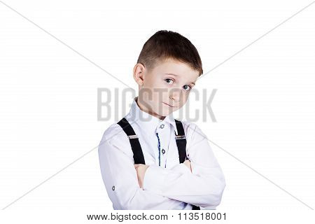 Little boy with wide open eyes looking to camera